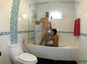 Wife showers with hubby and provides him a blowjob