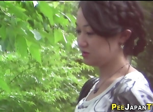 Asian nubile pees outdoors